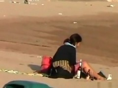 Voyeur tapes a crazy girl riding her bf upskirt at the beach