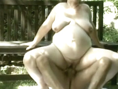 Chunky brunette moans while having her twat stretched outdoors