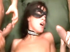 Masked babe eats cum and then gets her ass nailed and a DP in a threesome