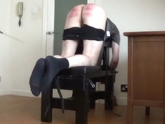 Miss Sultrybelle caning a naughty pupil.